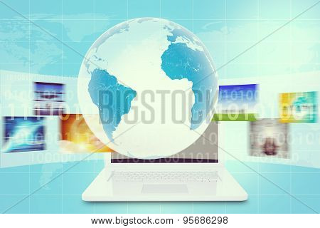 Earth in center above white laptop