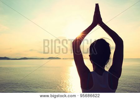 healthy yoga woman meditation at sunrise seaside