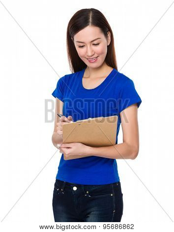 Young Woman write on clipboard