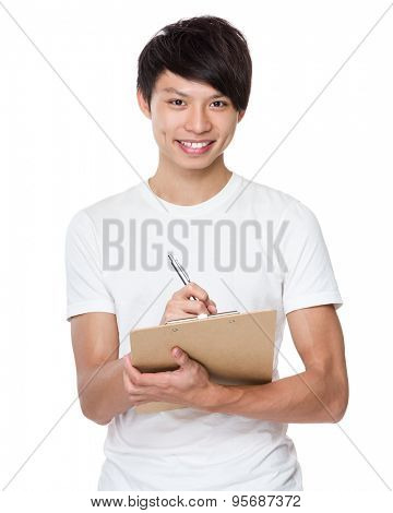 Asian man take note on clipboard