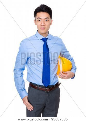 Engineer holding with safety yellow helmet