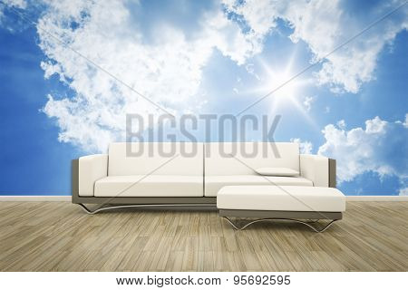 3D rendering of a sofa in front of a photo wall mural blue sky