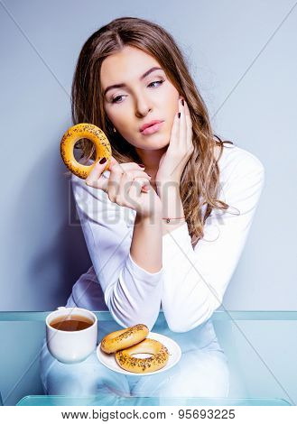 woman eating a bun, humorous portrait of a woman keeping a diet