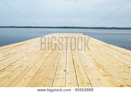 Landscape with the image of wooden jetty on Solovetsky Island in White Sea, Russia