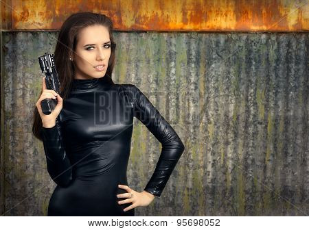 Spy Agent Woman in Black Leather Suit Holding Gun