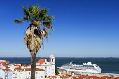 stock photo of passenger ship  - View of big passenger ship in Lisbon port from Alfama Miradouro - JPG