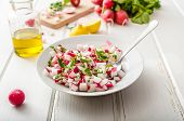 stock photo of radish  - Radish Spring salad with herbs fresh and delicious dressing from olive oil pepper salt and lemon juice and zest - JPG