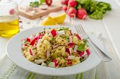 stock photo of radish  - Couscous with radishes and herbs topped herbs and olive oil simple but delicious vegetarian food - JPG