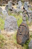 foto of stone sculpture  - Lava stone sculpture of an old man - JPG
