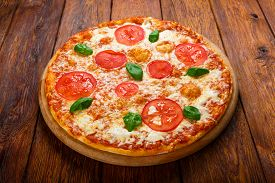 picture of crust  - Delicious italian Margherita pizza with tomatoes and mozarella  - JPG
