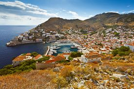 foto of hydra  - View of the port of Hydra and a large portion of town which extends further to the right - JPG