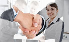 foto of politeness  - Male and female handshake in office - JPG