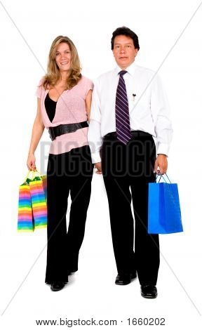 Couple With Shopping Bags Walking