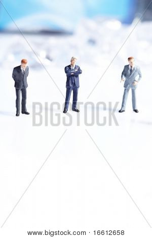 Business figurines standing