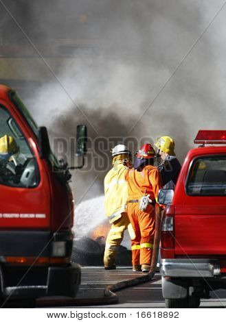 fire fighters extinguishing a fire