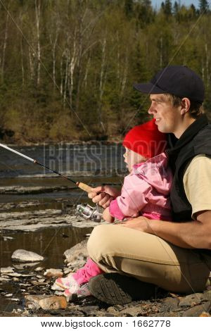 Dad And Daughter Fishing