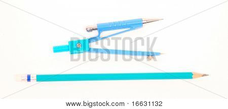 a note compass and pencil on white