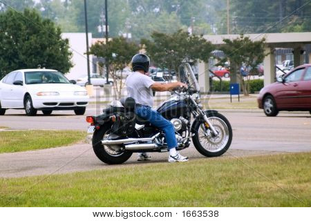 Motorcycle Rider About To Enter Traffic