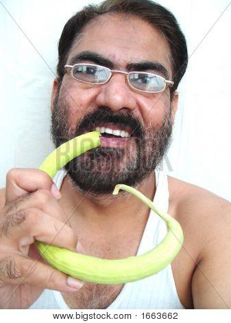 Indian Man  Eating Kakdi