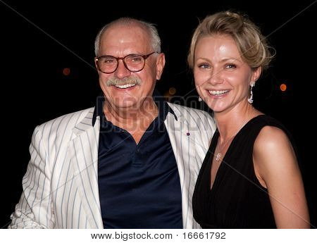 MOSCOW - JUNE 26: Director Nikita Mikhalkov and actress Maria Mironova. Afterparty Closing Ceremony Of 32nd Moscow International Film Festival at Pushkinsky Cinema. June 26, 2010 in Moscow, Russia.
