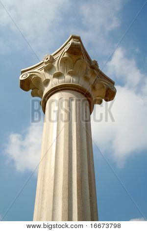 Top of white pillar against sky