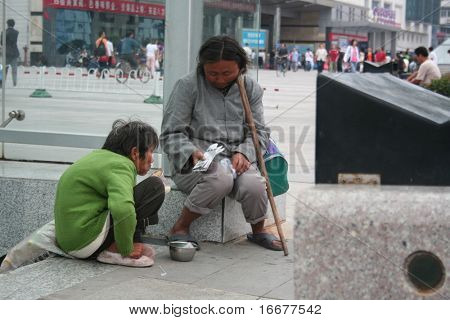 two female beggar  at street