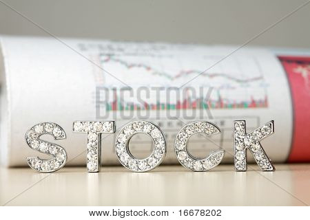 Text of �stock� with newspaper about stock