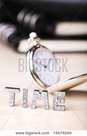 text of 'time' ,pocket watch with black notebook