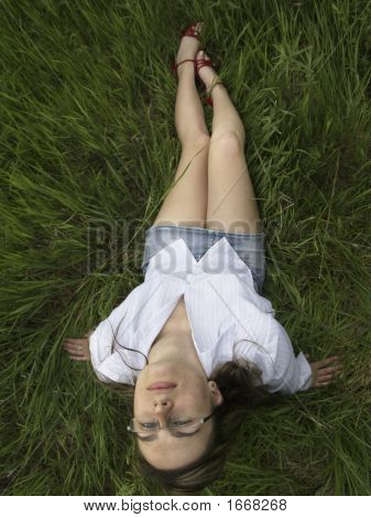 Beauty Girl In The Grass