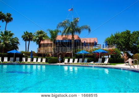 Girl Poolside In Palm Springs, California