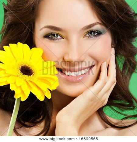 attractive smiling woman portrait on green background