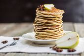 Постер, плакат: Whole Grain Pancakes With Pear Jam And A Slice Of Pear And Star Anise On Set Table