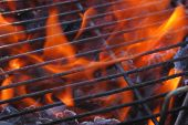 pic of barbie  - Just lighting the barbecue and the flames are coming up through the grill - JPG