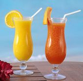 stock photo of orange-juice  - two fresh juice orange and papaya on the table on blue sky - JPG