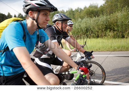 Bicyclists. Focused on middle cyclist.