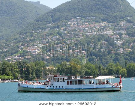 Cruiser ship with tourists on board. Lake Lugano, Switzerland