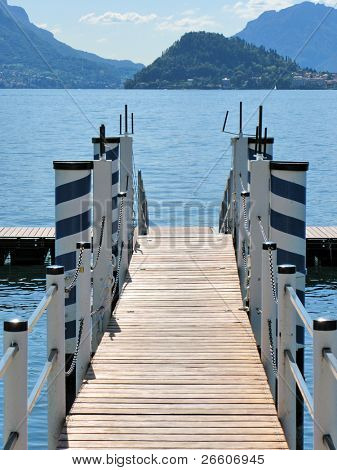 Wooden pier in Menaggio, lake Como, Italy