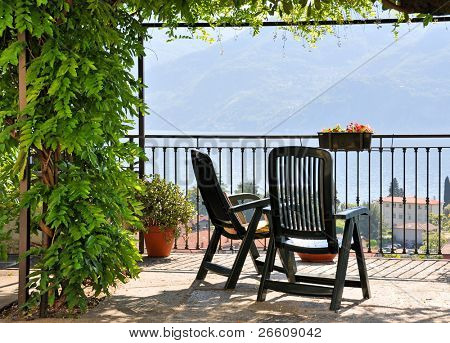 Two chairs overlooking lake Como, Italy