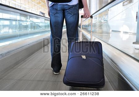 Traveller on the speedwalk