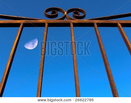The moon behind the bars of a cell of a prison