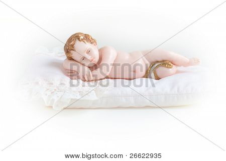 Little artistic sculpture of wax of jesus child isolated on white background
