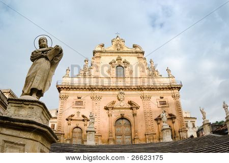Modica the baroque duomo of holy Peter  and the statue of a apostle