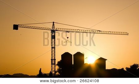 Crane for construction industry at sunset