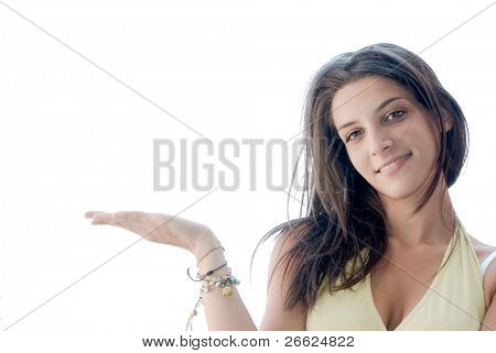 smiling girl showing something on the palm of hand