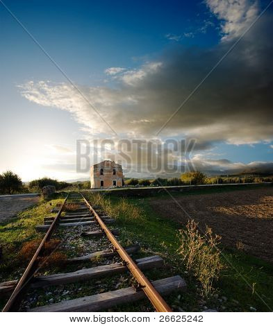 old railway and station abandoned to sunset