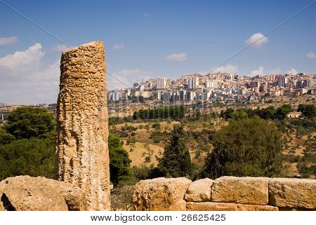 doric column on background city of Agrigento
