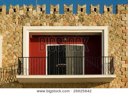 balcony in a stone wall with battlement