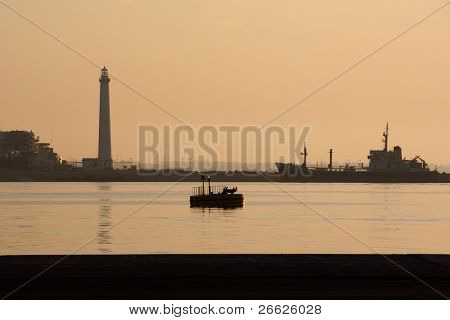the lighthouse of the Port of Bari in a sunset sultry