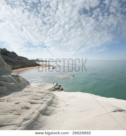 seascape of bay with white cliff and overcast sky