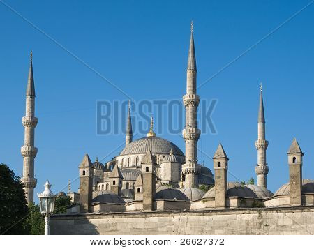 chimneys and minarets of blue mosque in Sultanahmet, Istanbul, against sky blue